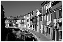 Canal lined with multihued houses, Burano. Venice, Veneto, Italy ( black and white)