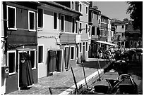 Canal bordered by multicolored  houses, Burano. Venice, Veneto, Italy ( black and white)