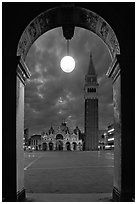 Campanile and Piazza San Marco (Square Saint Mark) seen from arcades at night. Venice, Veneto, Italy ( black and white)