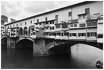 Ponte Vecchio (1345),  old bridge lined with shops. Florence, Tuscany, Italy ( black and white)