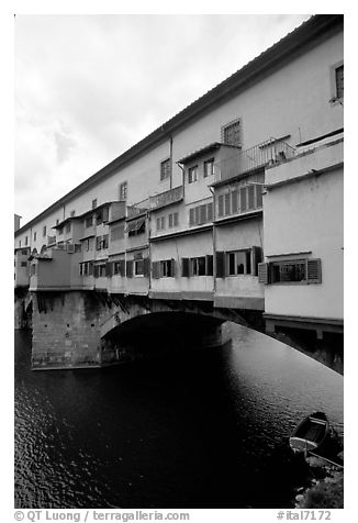 Ponte Vecchio bridge covered with shops, spanning  Arno River. Florence, Tuscany, Italy (black and white)