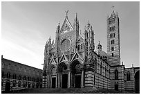 Siena Cathedral (Duomo) with bands of colored marble, late afternoon. Siena, Tuscany, Italy ( black and white)