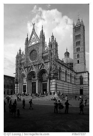 Richly decorated cathedral facade, afternoon. Siena, Tuscany, Italy (black and white)