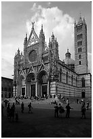 Richly decorated cathedral facade, afternoon. Siena, Tuscany, Italy ( black and white)