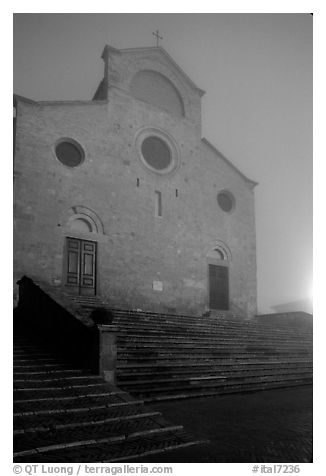 Duomo at dawn in the fog. San Gimignano, Tuscany, Italy (black and white)