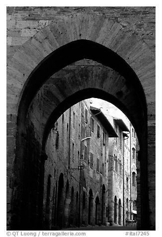 Arch and street. San Gimignano, Tuscany, Italy (black and white)