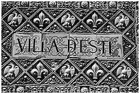 Ceramic sign at the entrance of Villa d'Este. Tivoli, Lazio, Italy (black and white)