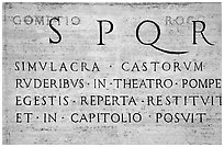 Inscription in Latin with the SPQR letters of the Ancient Roman Empire. Rome, Lazio, Italy ( black and white)