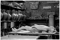 Artifacts found during the excavations, including a petrified man. Pompeii, Campania, Italy ( black and white)