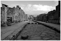 Street with roman period pavement and sidewalks. Pompeii, Campania, Italy ( black and white)