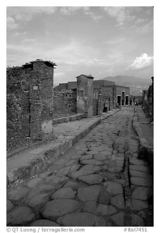 Paved street and ruins. Pompeii, Campania, Italy (black and white)