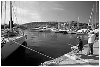 Fishing in the yacht harbor, Agropoli. Campania, Italy ( black and white)
