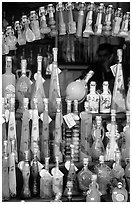 Bottles of Lemoncelo, the local lemon-based liquor, Amalfi. Amalfi Coast, Campania, Italy ( black and white)