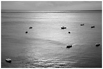 Small boats at sunset in the Gulf of Salerno, Positano. Amalfi Coast, Campania, Italy ( black and white)