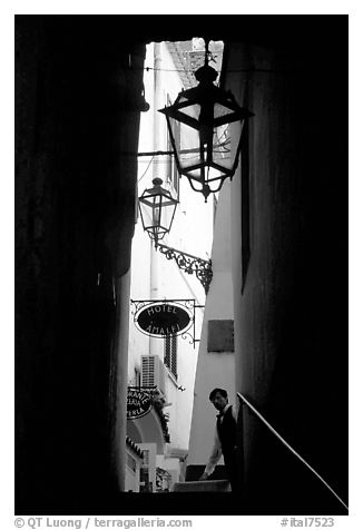 Narrow stairway with formally dressed man and hotel sign,  Amalfi. Amalfi Coast, Campania, Italy (black and white)