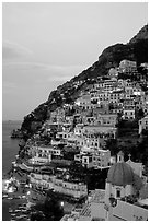 Positano at dawn, with the ceramic dome of Chiesa di Santa Maria Assunta in the foreground. Amalfi Coast, Campania, Italy ( black and white)