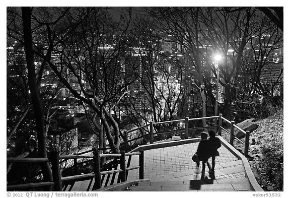 Couple walking down Namsan stairs by night. Seoul, South Korea (black and white)