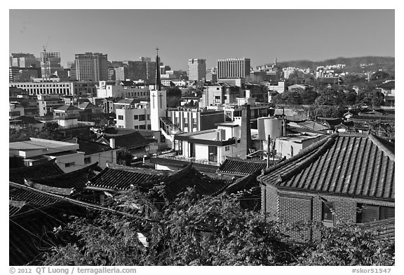 Hanok houses overlooking modern skyline. Seoul, South Korea (black and white)