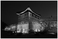 Suwon Hwaseong Fortress tower at night. South Korea (black and white)