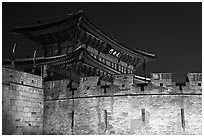 Wall and Janganmun gate at night, Suwon Hwaseong Fortress. South Korea (black and white)