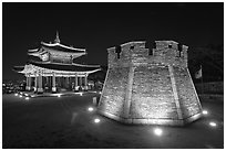 Crossbow tower and command post at night,  city lights, Suwon. South Korea ( black and white)