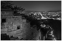Rampart wall and city lights, Suwon Hwaseong Fortress. South Korea (black and white)