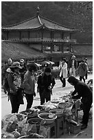 Hikers buy natural products near Haeinsa. South Korea ( black and white)