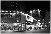 Pedestrian street lined up with outdoor equipment stores. Daegu, South Korea ( black and white)