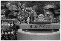 Water fountain and drinking cups, Seokguram. Gyeongju, South Korea ( black and white)