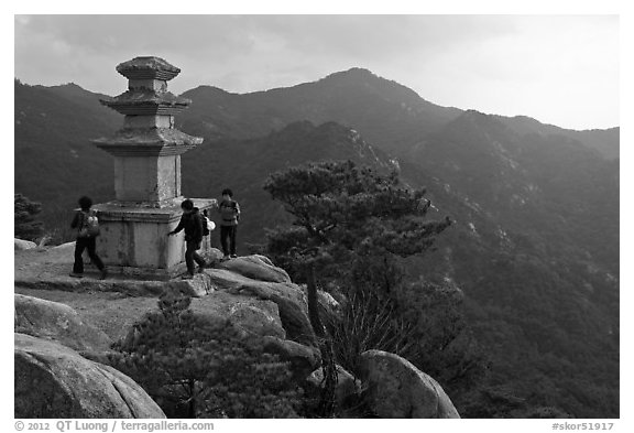 Women circling stone pagoda, Mt Namsan. Gyeongju, South Korea (black and white)