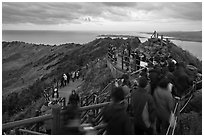 Tourists on top of Seongsang Ilchulbong. Jeju Island, South Korea (black and white)