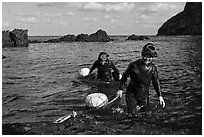 Haeneyo women walking out of water. Jeju Island, South Korea (black and white)
