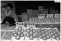 Tangerine fruit stand, Jeju. Jeju Island, South Korea (black and white)