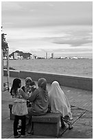 Women on waterfront. George Town, Penang, Malaysia ( black and white)