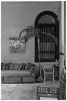 Chairs and blue wall, Cheong Fatt Tze Mansion. George Town, Penang, Malaysia (black and white)