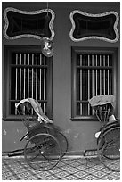Rickshaws and windows, Cheong Fatt Tze Mansion. George Town, Penang, Malaysia ( black and white)
