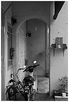 Motorcycle and altar outside townhouse. George Town, Penang, Malaysia ( black and white)