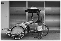 Driver and trishaw. George Town, Penang, Malaysia (black and white)