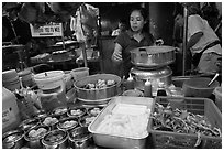 Woman serving dumplings. George Town, Penang, Malaysia ( black and white)