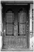 Old green door locked with chain. George Town, Penang, Malaysia ( black and white)