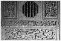 Octogonal window and stone carvings, Khoo Kongsi. George Town, Penang, Malaysia ( black and white)