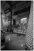 Altar and wheels in motion, Hainan Temple. George Town, Penang, Malaysia ( black and white)