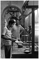 Man preparing nan bread in arcade. George Town, Penang, Malaysia ( black and white)