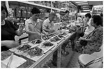 Store selling traditional Chinese medicine herbs. Kuala Lumpur, Malaysia (black and white)