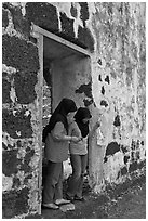Malay girls exit on St Paul church doorway. Malacca City, Malaysia ( black and white)
