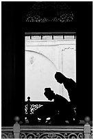 Silhouettes of men bowing in worship, Masjid Kampung Hulu. Malacca City, Malaysia (black and white)