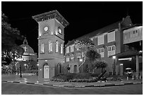 Town Square with Stadthuys, clock tower, and church at night. Malacca City, Malaysia ( black and white)