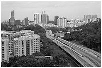Freeway bordered by parklands and high rises. Singapore ( black and white)