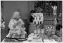 Huichol women selling crafts on the street, Tlaquepaque. Jalisco, Mexico (black and white)