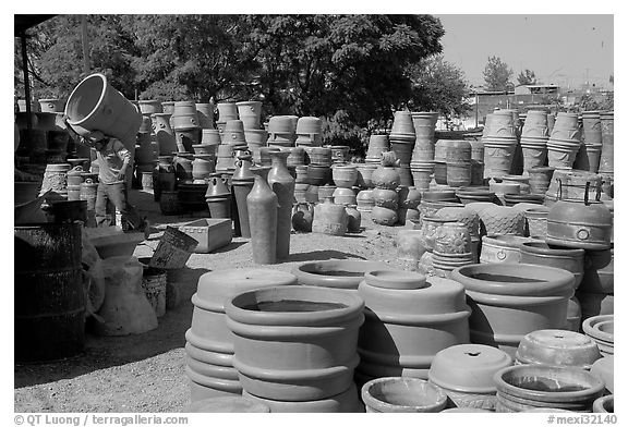 Pots for sale, with a man loading in the background, Tonala. Jalisco, Mexico